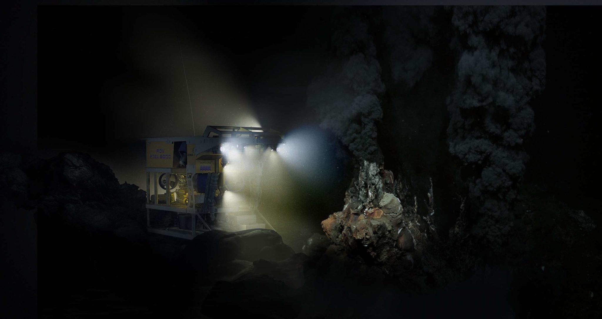 """Tauchroboter wie das ROV KIEL 6000 des GEOMAR können gefahrlos in die lebensfeindliche Umwelt der Tiefsee abtauchen. Mittels Beleuchtung und hochauflösender Bild- und Videokameras bringen sie spektakuläre Bilder und Filme aus der Tiefsee in Echtzeit an Bord. Hier beleuchtet der Roboter die für heiße Quellen typischen Schlote der """"Schwarzen Raucher""""."""